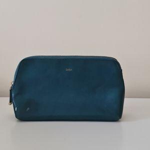 Used SABA, emerald green leather clutch/ purse